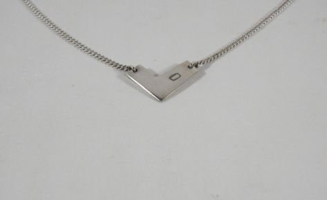 The geometric heart – women's silver necklace